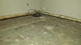After the homeowner had removed the carpet to remodel, large gaps were exposed, showing the sinking slab foundation.