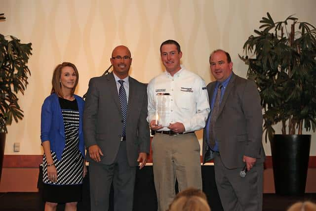Sales Manager Erik Tatge receiving BBB award