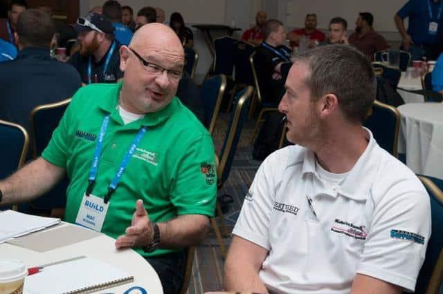 Sales Manager, ErikTatge, and Design Specialist Mac McDanielat 2015 Convention